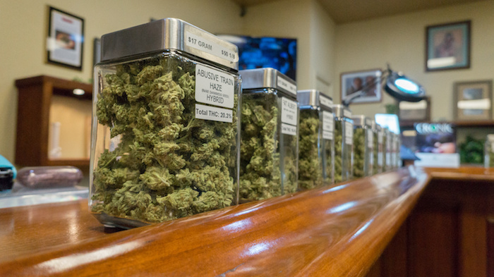 Jars of loose bud are shown in an unlicensed dispensary.